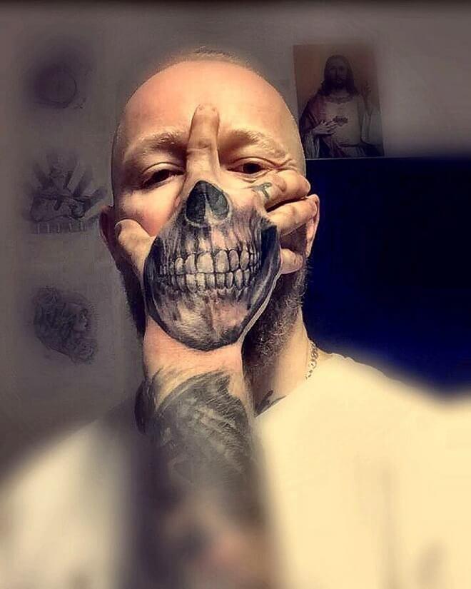 Hand Skull Tattoos