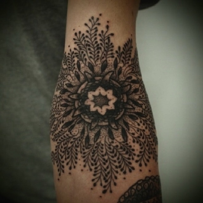 black flower henna tattoo
