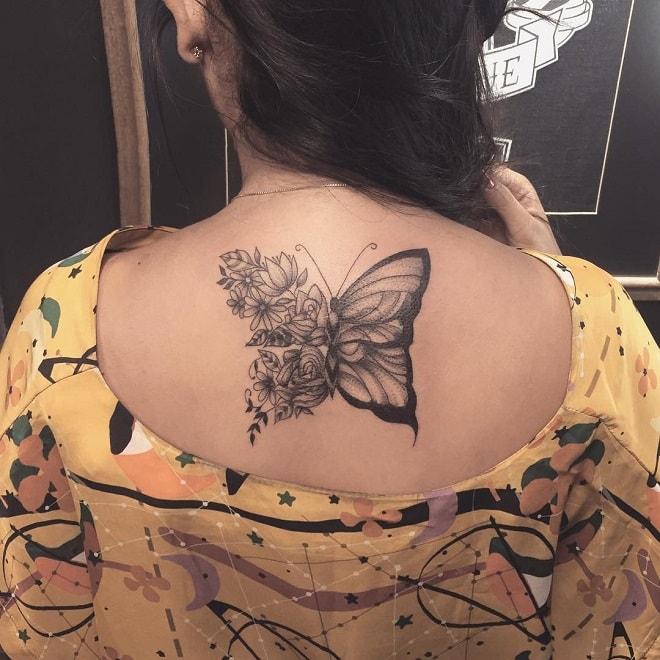 blackwork butterfly tattoo