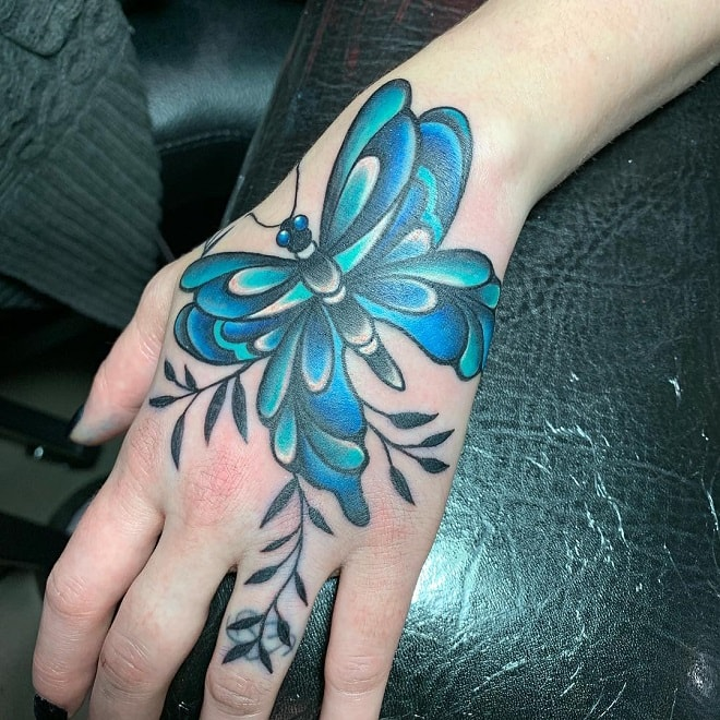 hand butterfly tattoo