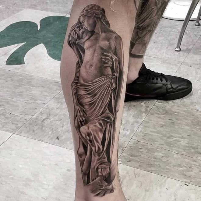 Black And Grey Leg Tattoo