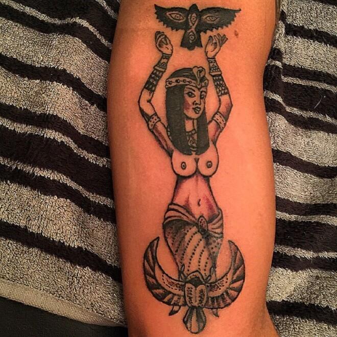 Black Inked Egyptian Tattoo