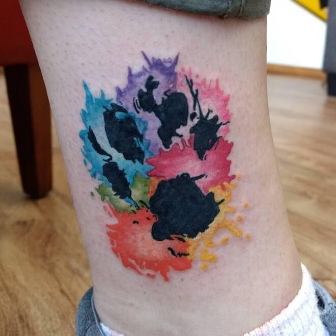 Dynamic Ink Paw Print Tattoo
