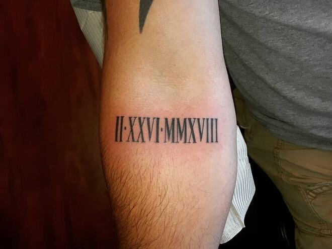 Forearm Roman Numeral Tattoo