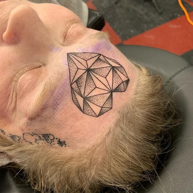 Geometric Face Tattoo