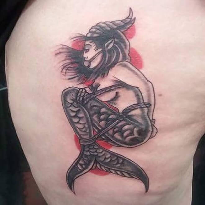 Girl With Fish Capricorn Tattoo