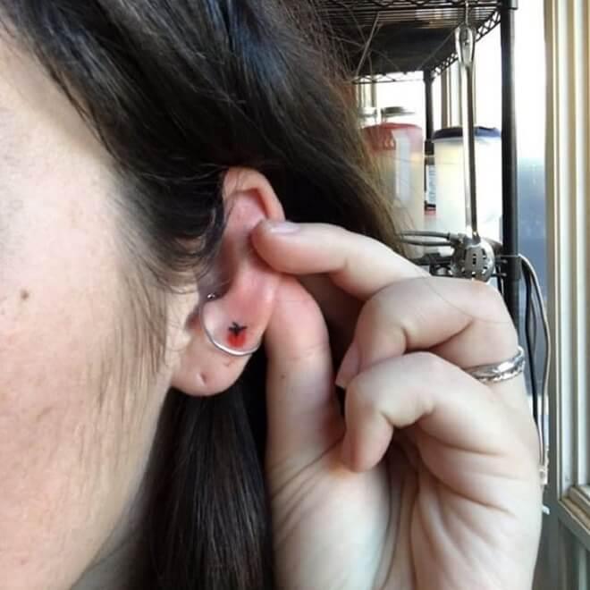 Hand Poke Ear Tattoo