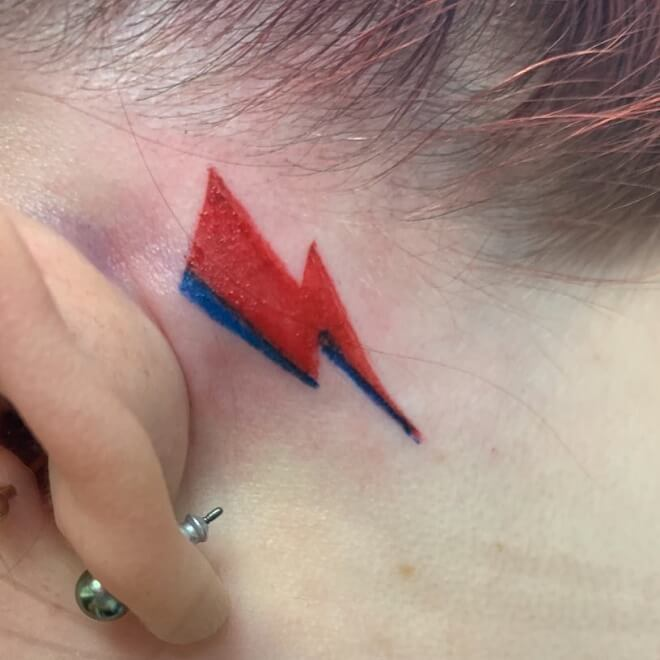 Red And Blue Ear Tattoos