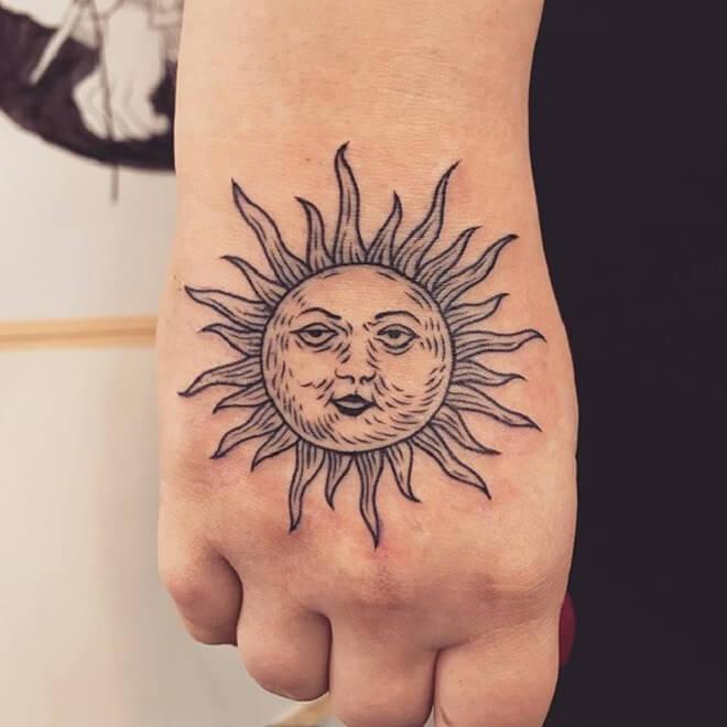 Hand Sun Designs Tattoo