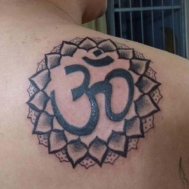 Black Work Om Tattoo