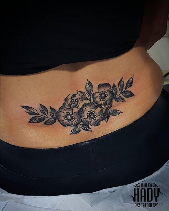 Lower Back Black Tattoo