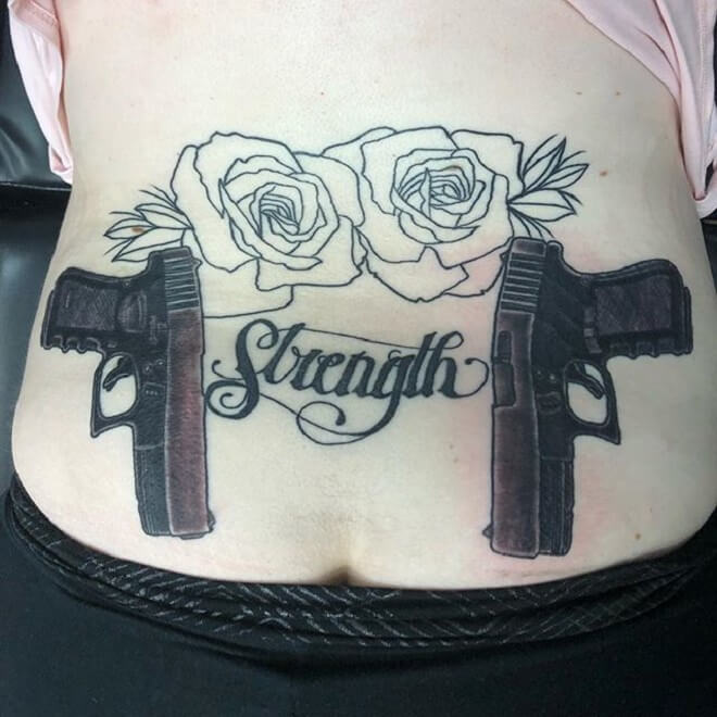 Lower Back Gun Tattoo