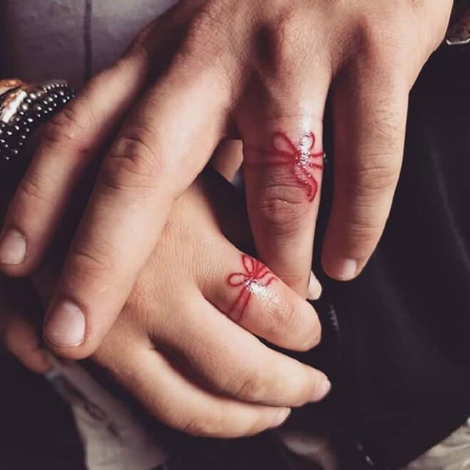 Red Wedding Ring Tattoo