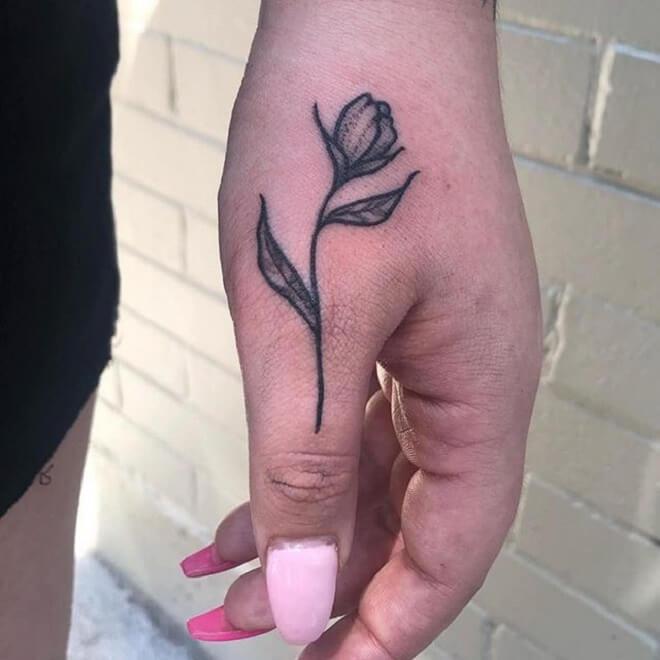 Flower Thumb Tattoo