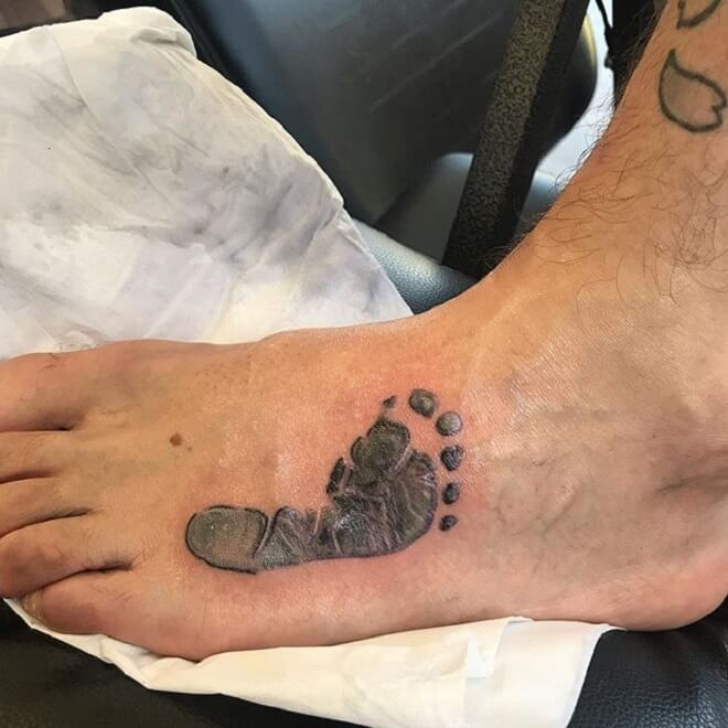 Leg Footprint Tattoo