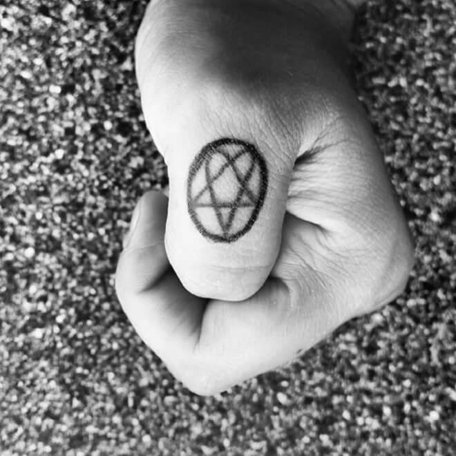 Simple Thumb Tattoo