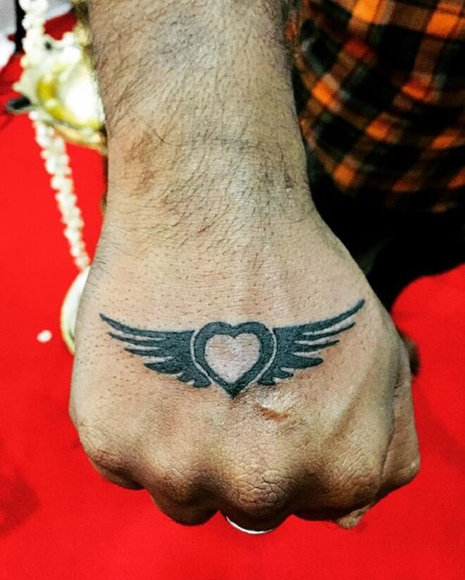 Small Heart with Wings Tattoo