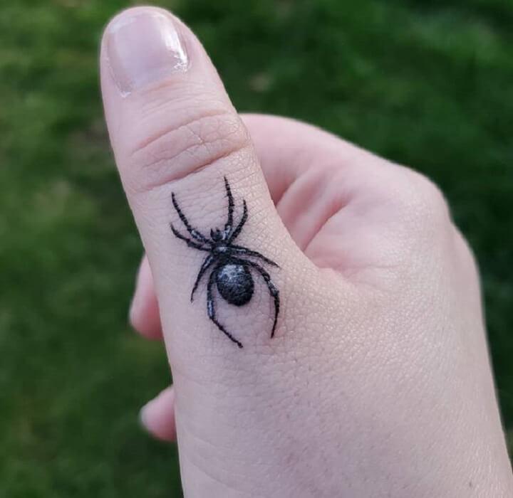Top Thumb Tattoo