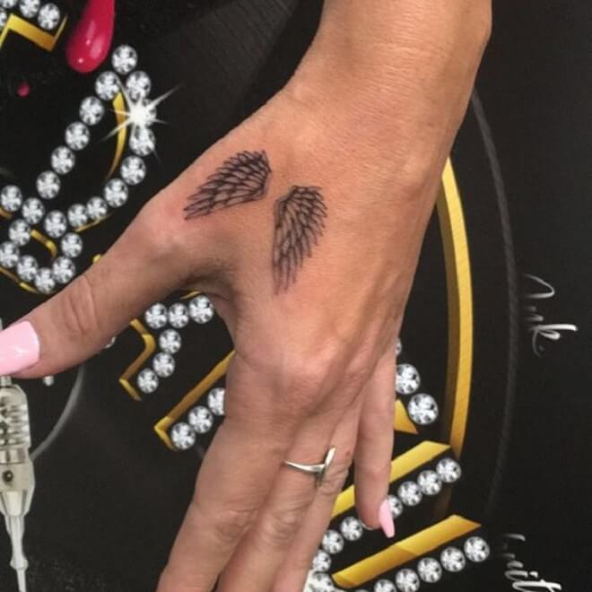 Hand Wing Tattoo