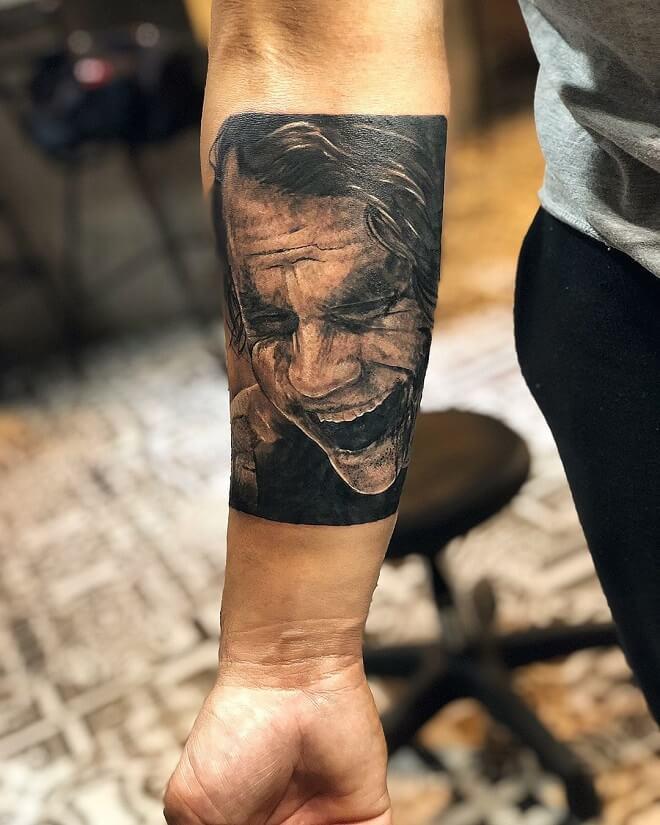 Laughing joker tattoo